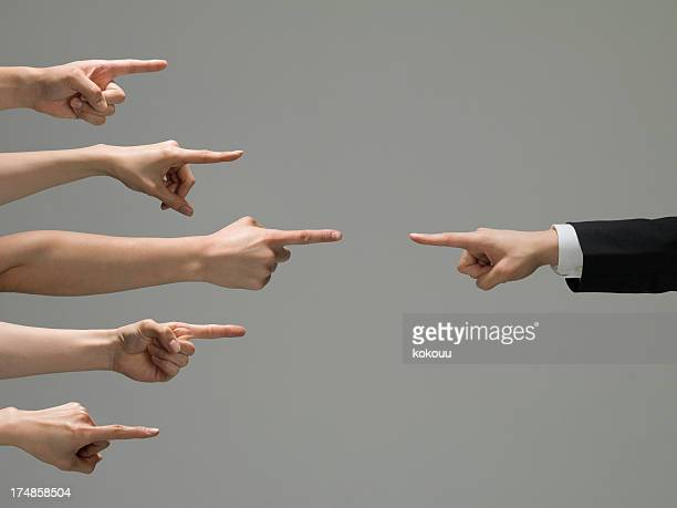 People who point at a businessman