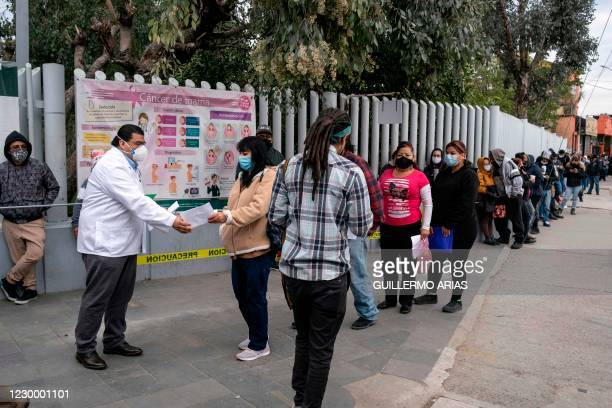 People who suspect they have COVID-19 line up for a second checking at IMSS Family Clinic in Tijuana, Baja California State, Mexico, on December 7...