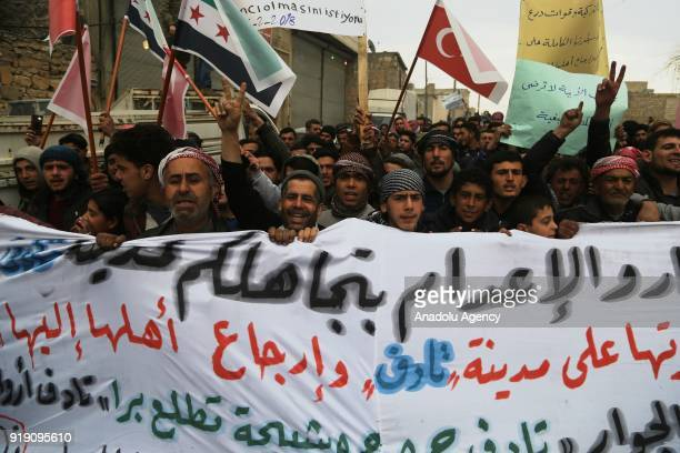 People who used to live in Tadef hold a banner during a protest demanding Assad Regime forces to leave Tadef in Al Bab district which was cleared...