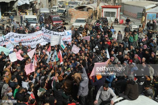 People who used to live in Tadef hold banners and placards during a protest demanding Assad Regime forces to leave Tadef in Al Bab district which was...