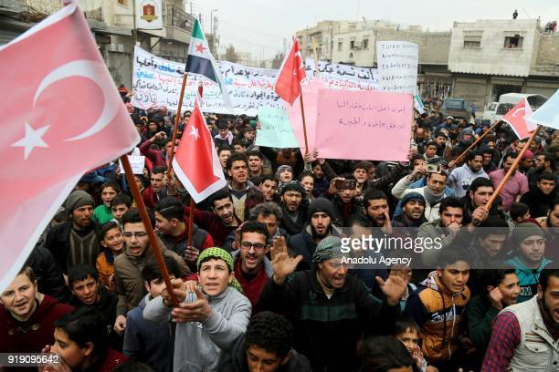 People who used to live in Tadef hold banners and Turkish flags during a protest demanding Assad Regime forces to leave Tadef in Al Bab district...