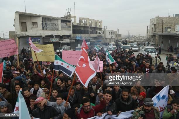 People who used to live in Tadef hold placards and a Turkish flag during a protest demanding Assad Regime forces to leave Tadef in Al Bab district...