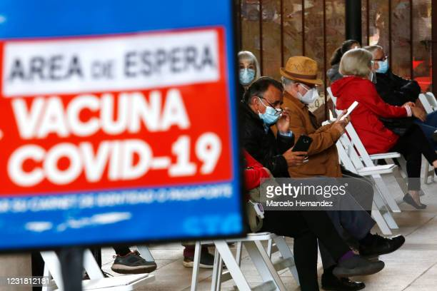 People who were already vaccinated wait 30 minutes for reactions on March 19, 2021 in Santiago, Chile. The Andean country already inoculated over 5.5...