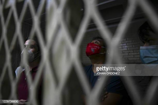 People who were detained during a protest demanding the resignation of Guatemalan President Alejandro Giammattei, remain in a security cell in...