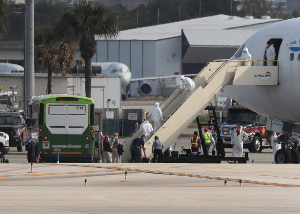 FL: Passengers From The Rotterdam Cruise Ship Board Planes Home
