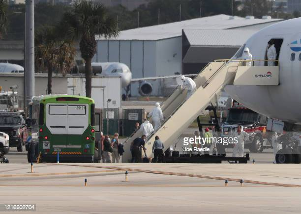 People who were passengers on the Zaandam and Rotterdam cruise ship board an Eastern Airlines charter flight at Fort LauderdaleHollywood...