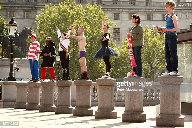 People who will stand on the empty fourth plinth in Trafalgar Square practice standing on bollards on May 15 2009 in London Artist Antony Gormley's...