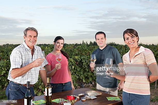 People wine tasting at vineyard