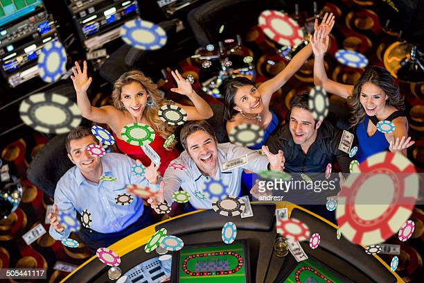 people winning at the casino - casino stock pictures, royalty-free photos & images