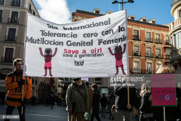 People with a banner that reads International day of zero tolerance with female genital mutilation protesting against female genital mutilation