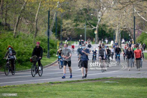 People with and without masks avoid social distancing in Central Park as temperatures rose amid the coronavirus pandemic on April 25 2020 in New York...