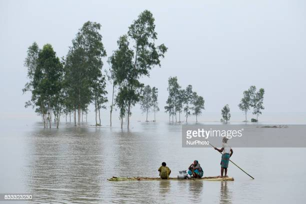 A people with banana boat moves to other place for continuous flooding in Sariakandhi area at Bogra Bangladesh 16 August 2017 Peoples suffering...