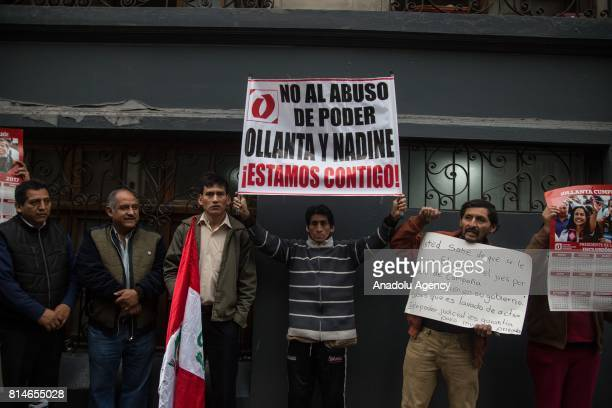 People with banners stage a demonstration in support to former Peruvian President Ollanta Humala while a vehicle transports him and his wife Nadine...