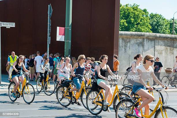 People with bike visting Berlin Wall Monument