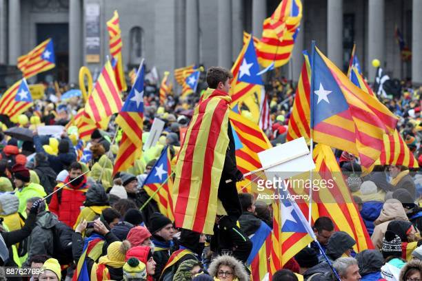 People with Catalan 'Estelada' flags stage a proindependence demonstration on December 7 2017 in Brussels Belgium Organised by proindependence civil...