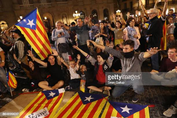 People with Catalan independence flags gather in front of the Palau de la Generalitat de Catalunya the building that houses the Catalonian presidency...