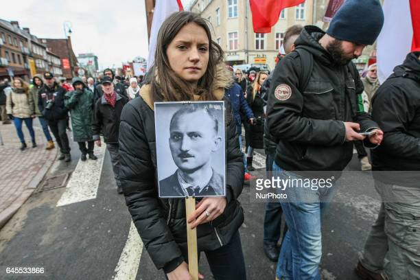 People with Cursed soldiers portraits are seen during the Cursed soldiers Day parade on 26 February 2017 in Gdansk Poland The Cursed soldiers were a...