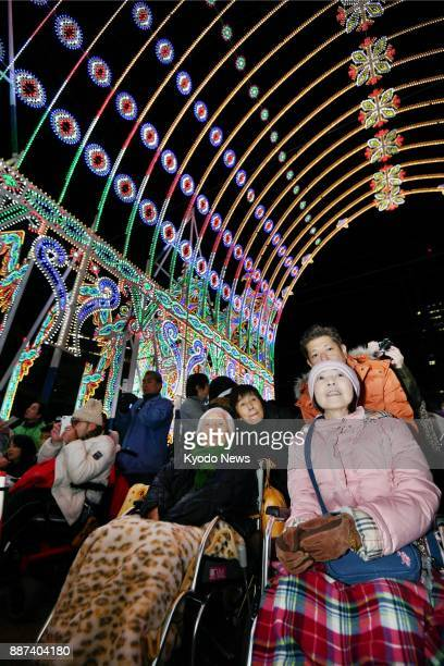 People with disabilities visit the venue of the Kobe Luminarie light festival in Kobe on Dec 6 2017 The organizers invited them two days before the...