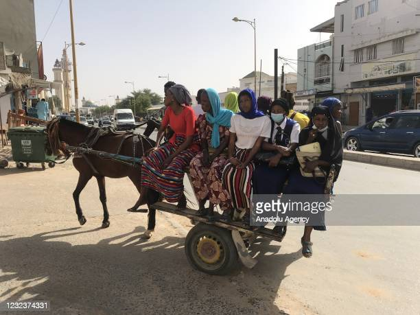 People with donkey carts are seen at a street in Dakar, Senegal on April 16, 2021. In the rural areas of the West African country Senegal, donkey...