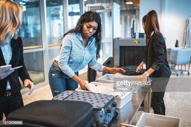 People with luggage at security check in airport