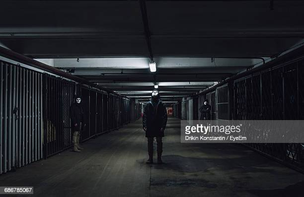 People With Masks Standing In Garage