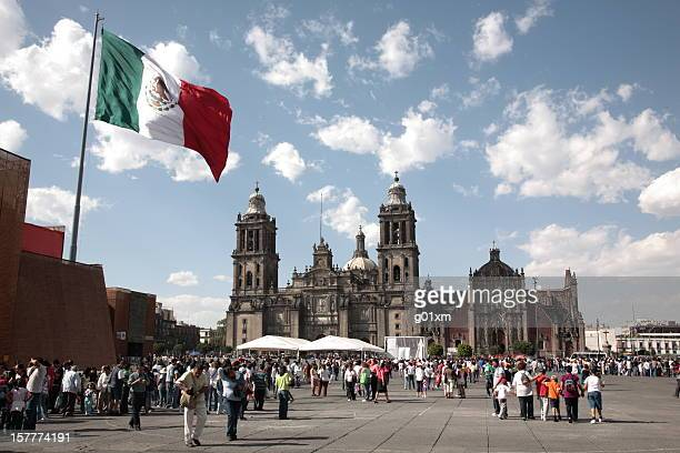 People with Metropolitan cathedral in Mexico city, Mexico.