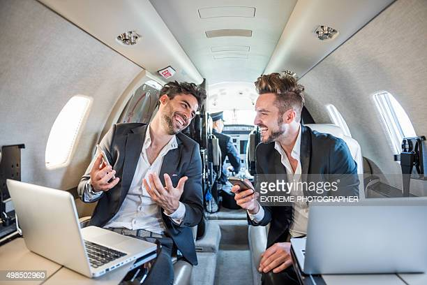 People with notebooks in private airplane
