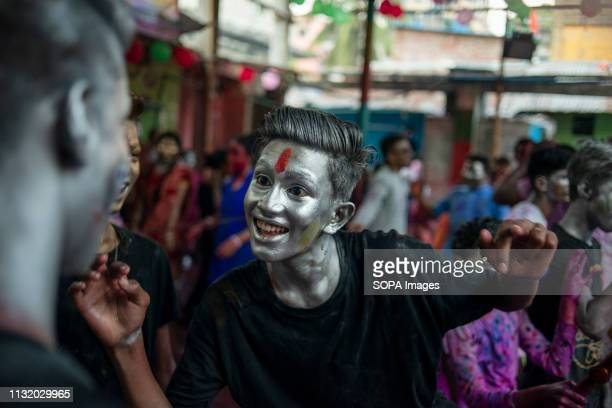 People with painted faces seen dancing in a cheerful mood during the celebration Holi known as the festival of colour is an ancient Hindu spring...