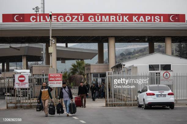 People with permission documents cross the Turkish Cilvegozu Border Gate from Syria on February 28, 2020 in Hatay, Turkey. Turkey announced that it...