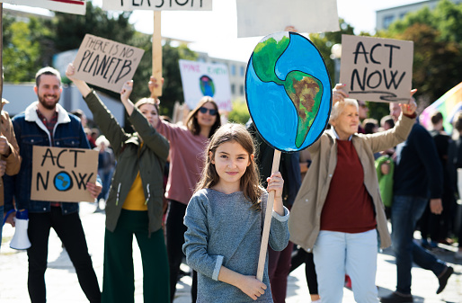 People with placards and posters on global strike for climate change. 1181043800