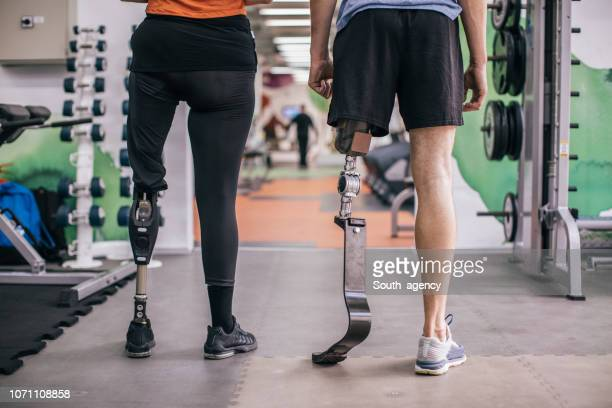 people with prosthetic legs in gym - fake man stock photos and pictures