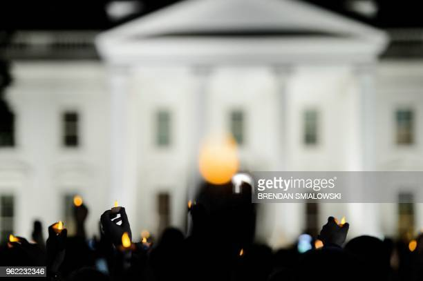 People with Reclaiming Jesus Declaration hold electronic candles during a vigil outside the White House May 24 2018 in Washington DC in response to...