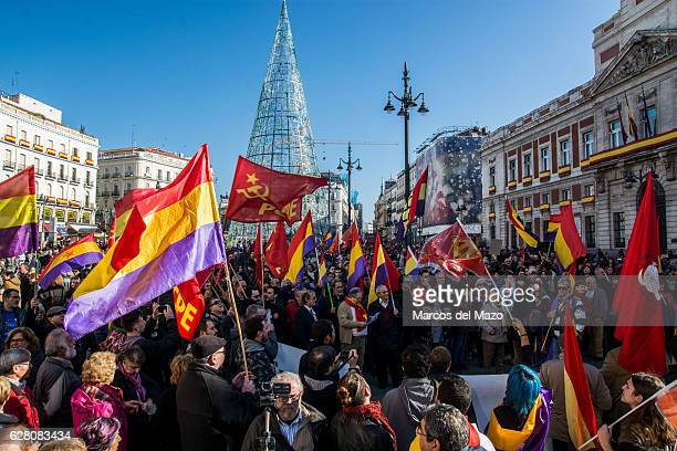 People with republican and communist flags protesting against Monarchy and demanding a Republic during the anniversary of the Spanish Constitution