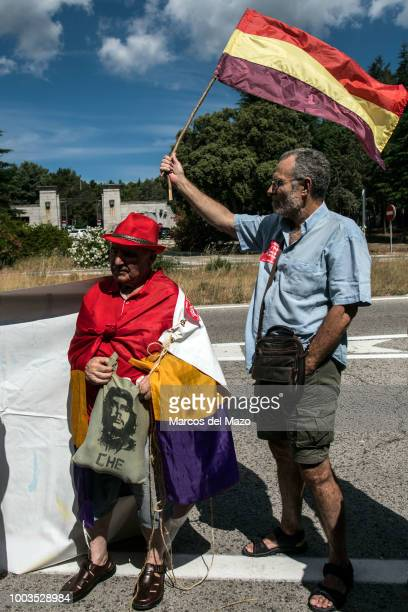 "People with republican flags protesting at the entrance of ""Valle de los Caidos"" monument to demand the removal of Franco and Primo de Rivera's..."