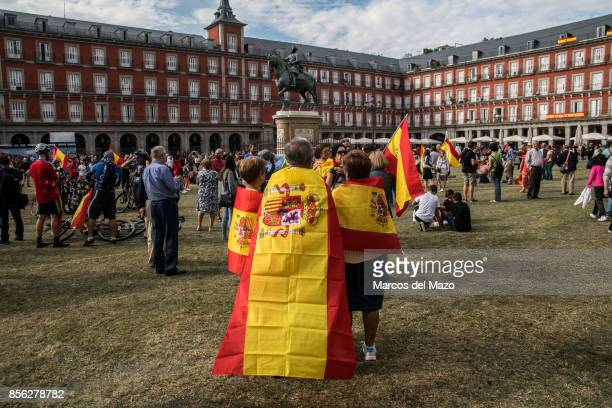 People with Spanish flags protesting in Plaza Mayor demanding the unity of Spain and against referendum in Catalonia