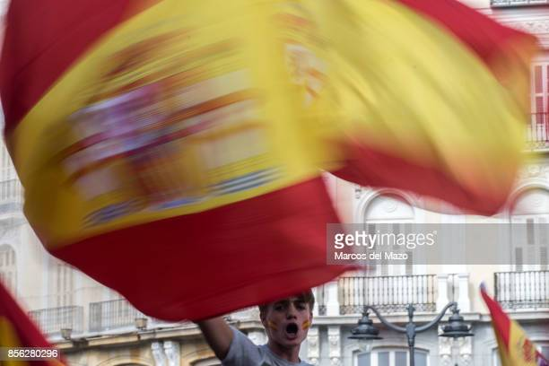 People with Spanish flags protesting in Sol Square demanding the unity of Spain and against referendum in Catalonia