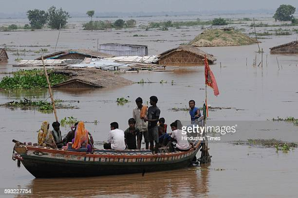 People with their belongings from flooded Diara areas near Patna leaving for a safer place on August 21 2016 in Bihar India The rising water level of...
