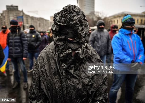 People with their eyes and mouths covered with black cloth take part in a silent flash mob outside the government's headquarters to denounce the...