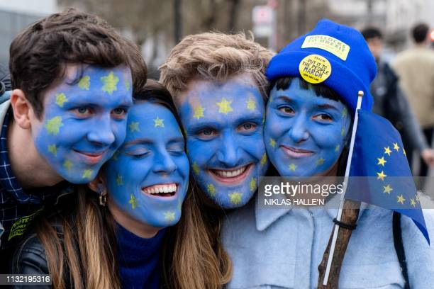 TOPSHOT People with their faces painted in European flag colours attend a rally organised by the proEuropean People's Vote campaign for a second EU...