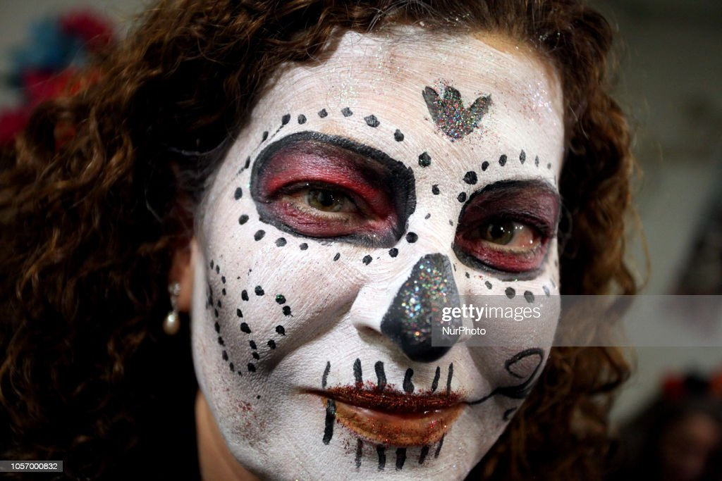 People With Their Faces Painted Take Part At The Annual Day Of The