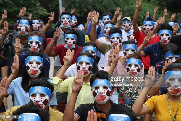 People, with their masks, stage a demonstration to protest against military coup in Yangon, Myanmar on April 04, 2021.