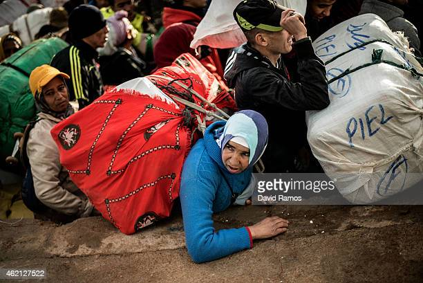 People with their packages wait to cross the 'Barrio Chino' border crossing point between Melilla and Morocco on January 20 2015 in Melilla Spain...