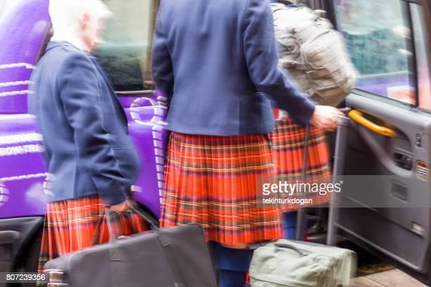 People with traditional kilt skirt at glasgow scotland england