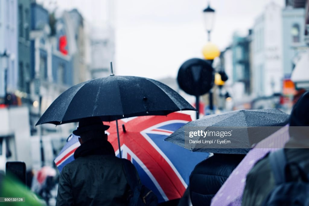 People With Umbrella Walking In City During Rainy Season : Stock Photo