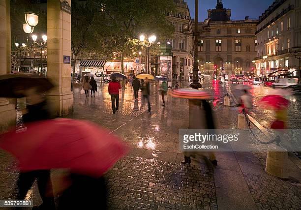 People with umbrellas at center of Paris