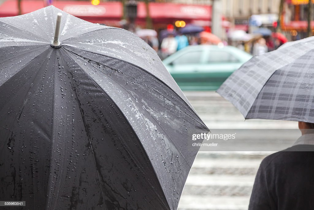 people with umbrellas in the rainy city : Stock Photo