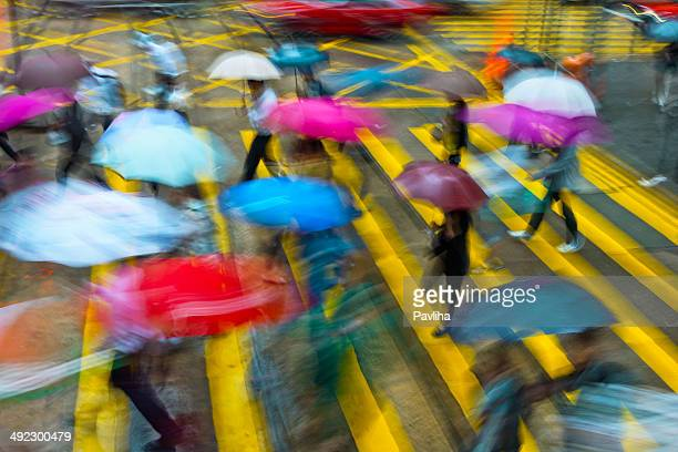 People with Umbrellas on Streets of Hong Kong,China,Asia