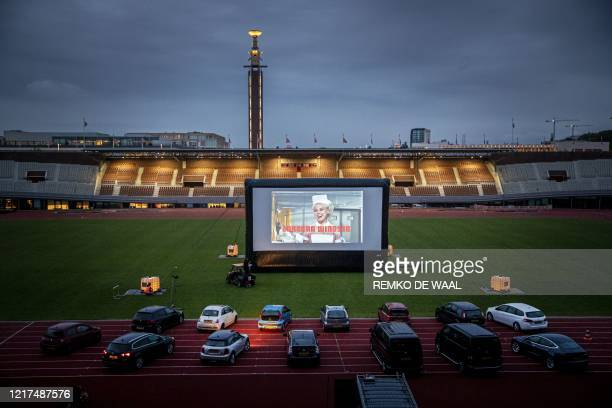 People with vital professions attend a screening of a film by Dutch director Martin Koolhoven during the first drivein openair cinema at the Olympic...