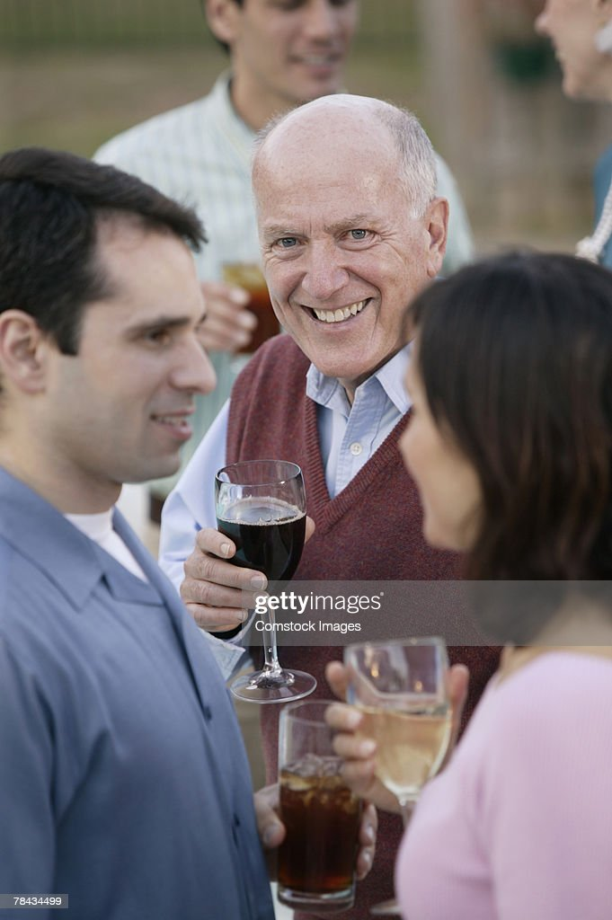 People with wineglasses at party : Stockfoto
