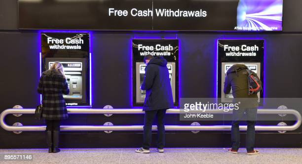 People withdraw cash from free ATM cash machines on December 16 2017 in London England